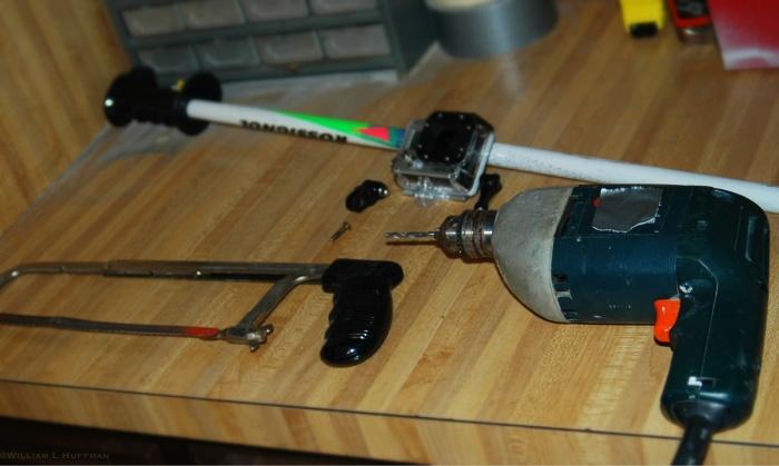 Hacksaw, drill, GoPro camera, GoPro thumb knob, 1/8 screw, ski pole